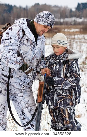 Hunter Shows His Son How To Charge The Sporting Gun
