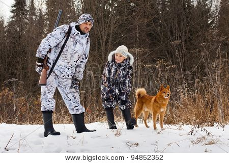 Hunter With His Son On Winter Hunting