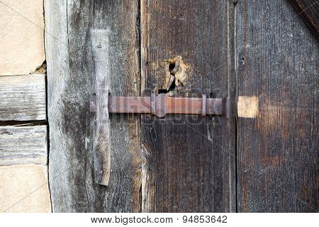 Close-up Of An Old Rustic Wooden Barn Door