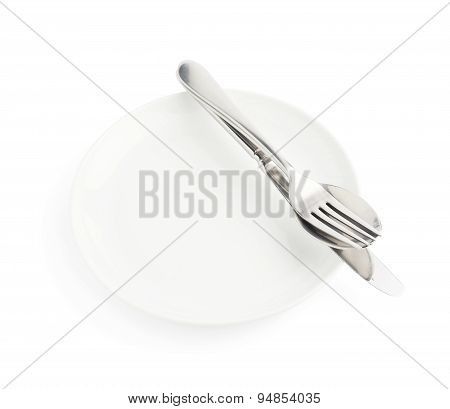 Spoon, fork and knife over the white plate