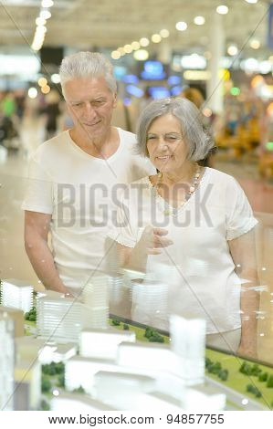 elderly couple in shopping mall