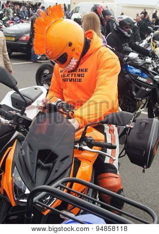 Biker in orange costume