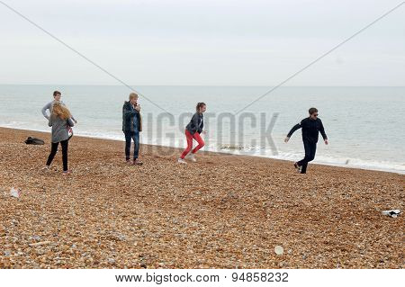 Teenagers having fun on Hastings beach