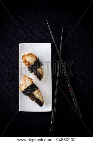 Two Nigiri Eel Sushi With Chopstick