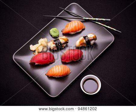 Eel, Salmon And Tuna Sushi With Chopsticks
