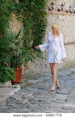 Girl In White Dresses Walking In The Street