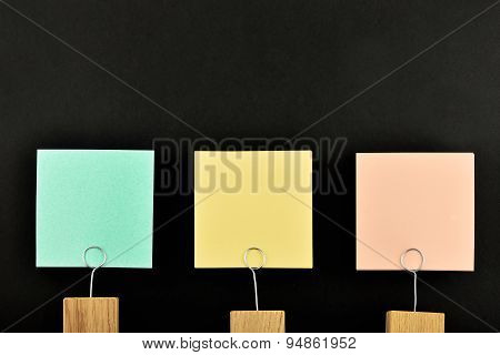 Three Paper Notes With Holder Isolated On Black For Presentation