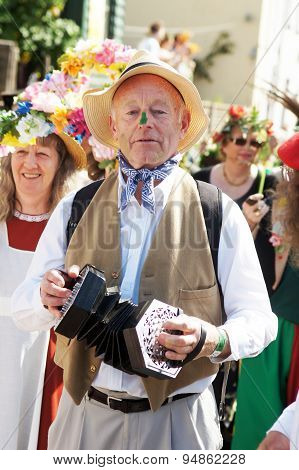 Man in costume play instrument during the carnival