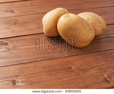 Pile of brown potatoes composition