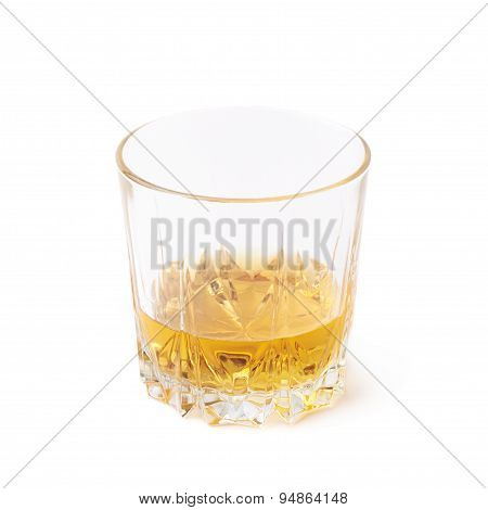 Glass tumbler filled with whiskey isolated