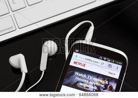 Netflix Service Logo On Phone.