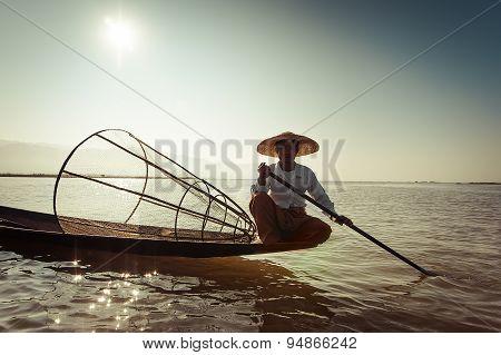 Burmese Fisherman Catching Fish In Traditional Way. Inle Lake, Myanmar