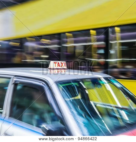Abstract Cityscape Blurred Background With Taxi Car. Hong Kong