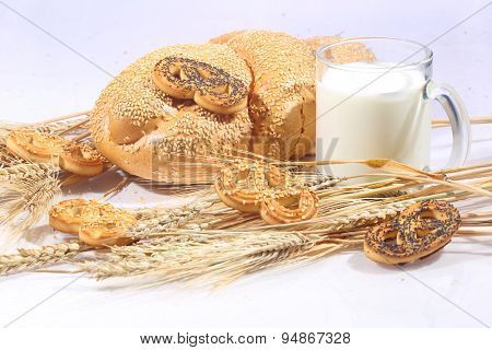 Milk And Roll From Wheat Flour Of A House Batch On A White Background