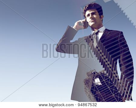 Double Exposure Of Young Businessman Using Mobile