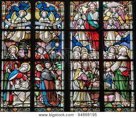 Stained Glass - Nativity Scene At Christmas And Resurrected Christ