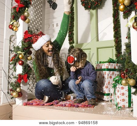 happy family on Christmas in red hats waiting gests and smiling