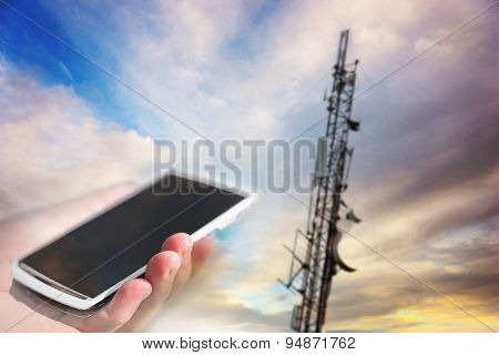 Mobile Phone Aiming At Telecommunication Tower
