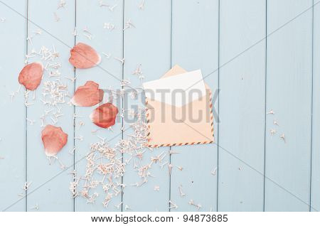 Flower Petals And Card In Vintage Postage Envelope