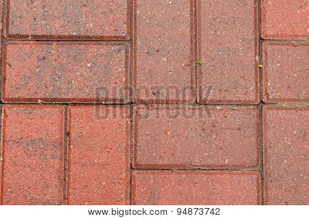 Wet red brick patio