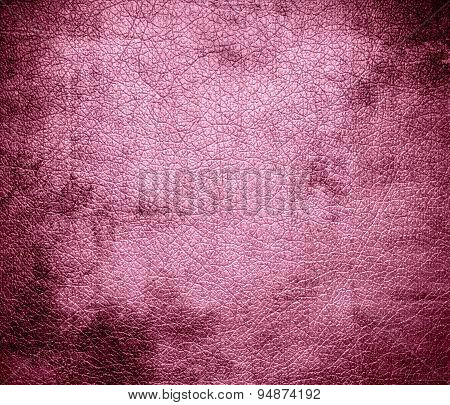 Grunge background of amaranth pink leather texture