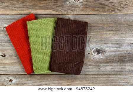 Colorful Cleaning Clothes On Rustic Wooden Boards