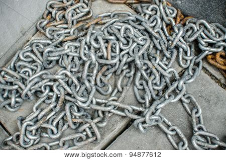 Old chain on a cement floor