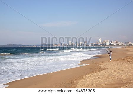 Fisherman Fishing In Indian Ocean At Durban, South Africa