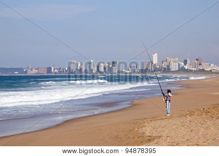 Single Fisherman Fishing In Ocean At Durban, South Africa