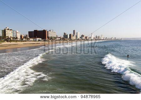 People On Beach Against Durban City Skyline
