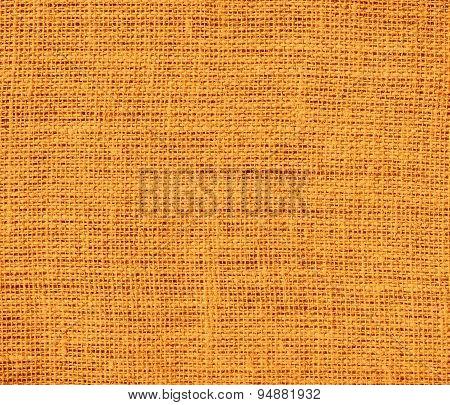 Deep saffron burlap texture background