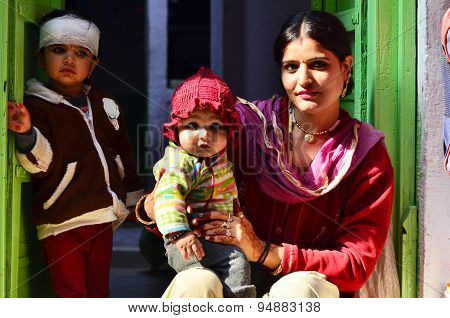 Jodhpur, India - January 1, 2015: Indian Proud Mother Poses With Her Children In Jodhpur