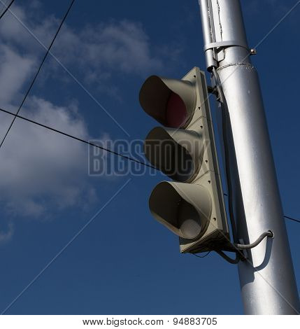 Unlit Traffic Light On Silver Post