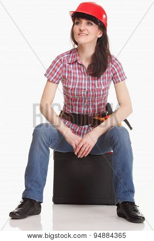 Woman In A Helmet Sits In The Tool Box