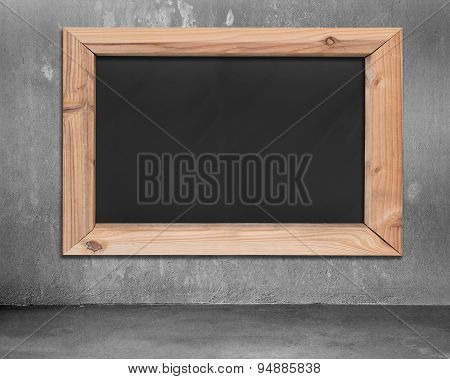 Blank Blackboard With Wooden Frame Hanging On Concrete Wall