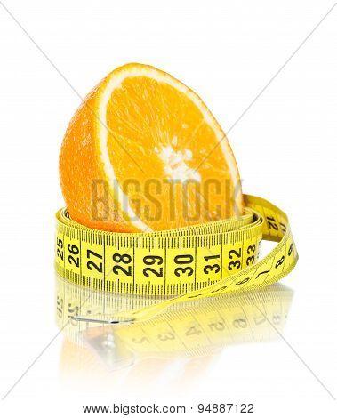 half orange with centimeter isolated on white background