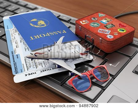 Travel Concept. Passports, Airline Tickets, Sunglasses, Airplane And Suitcase On The Keyboard. Onlin