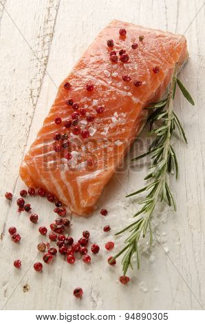 Raw Salmon Fillet On White Rustic Wood