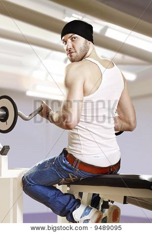 Man In Gym With Bar