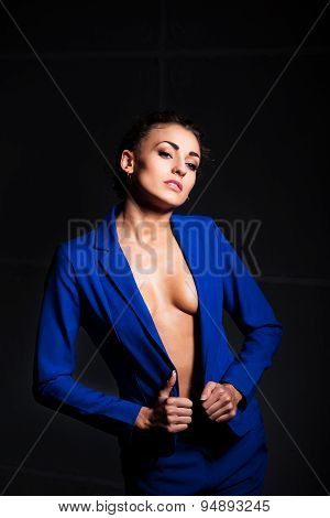 Sexy young woman with perfect body wearing blue jacket and pants. Beautiful fashion model posing in