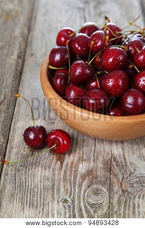 Ripe Cherry In A Wooden Bowl