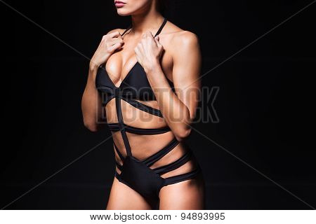 Sexy torso of young woman with perfect breast wearing black lingerie. Beautiful fashion model posing