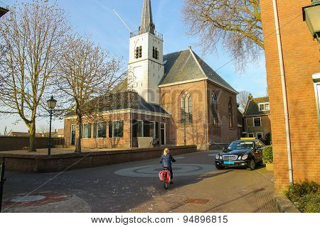 Little Girl Riding A Bicycle In The Dutch City Meerkerk, Netherlands