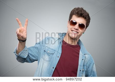 Cheerful Guy Making Victory Sign