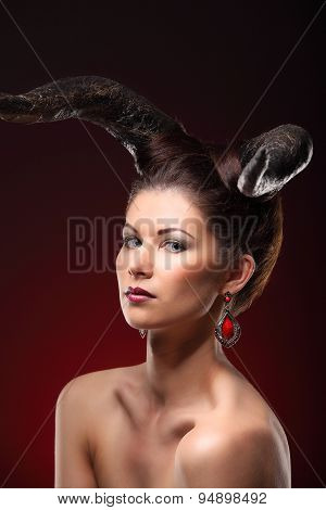 The Beautiful Young Girl With Horns Like Devil Or Angel