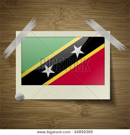 Flags Saint Kitts Nevis At Frame On Wooden Texture. Vector