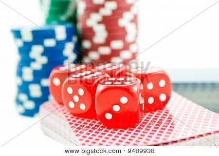Poker Chips, Cards And Red Dice Cubes