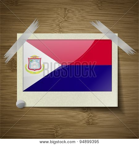 Flags Saint Martin At Frame On Wooden Texture. Vector