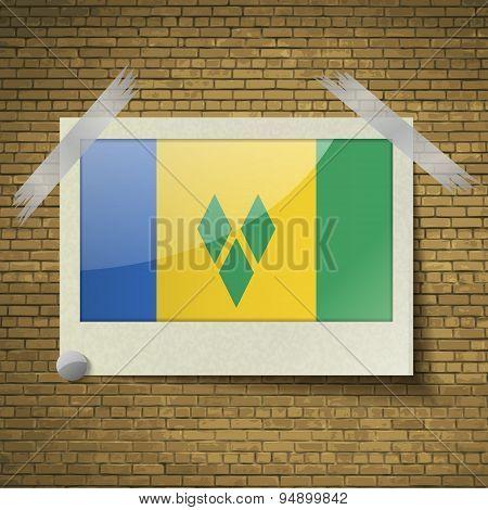 Flags Saint Vincent Grenadinesat Frame On A Brick Background. Vector