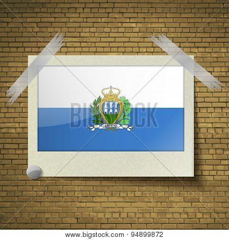Flags San Marinoat Frame On A Brick Background. Vector
